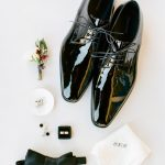 Wedding groom accessories details flatlay with boutonniere from Elegant Fusion Wedding