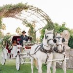 Wedding Ceremony horse and carriage Empire Polo Club RMBO Collective Destination Wedding Planner