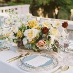 dinner tablescape with gold and robin's egg blue accented plates and colorful florals with warm pops of gold and burgundy wedding planning event design.