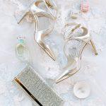 Bride wedding accessories flatlay Jimmy Choo The Mrs. Box from Elegant Fusion Wedding