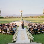 Wedding Ceremony in the round bride and groom floral aisle Empire Polo Club Elegant Fusion Wedding