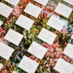 Wedding calligraphed escort cards floral elegant fusion wedding