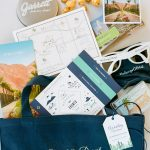 Welcome bag with map sunglasses popcorn from Elegant Fusion Wedding