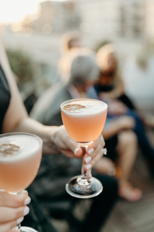 Specialty cocktails with dried orange garnish