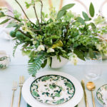 Modern and vintage tabletop items intermingle in this fresh tablescape for a backyard baby shower.