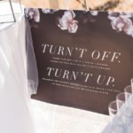 An unplugged ceremony sign reminds guests to turn off their cell phones and be in the moment.