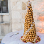 A croquembouche cake is an elegant option for this destination wedding in wine country.