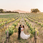 A bride and groom pose for a photo at their Joyful and Colorful Destination Wedding in California Wine Country